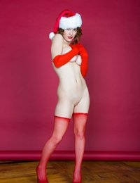 As we head into Xmas weekend, we're bringing back our pretty pinup girl Kymberly with her annual holiday goodies - this time with dozens of never-before-seen shots from the California studio.  (There may also be some video footage of this shoot laying around the office, so we'll see if we can find that too..)