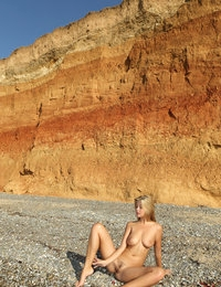 Marvelous long haired slender hottie showing milky boobs and vicious quim on the coast.