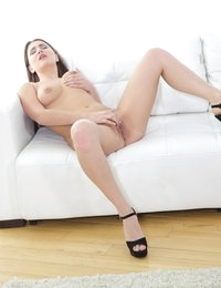 Hot brunette with beautiful eyes, silky hair, round tits and very tight ass doesn't want to do anything but having fun. It means self-adoration and slow striptease with something naughty afterwards. The beauty takes off the tiny shorts and top, leaving only high-heeled shoes. Then the babe shakes her ass and shows the pink muff between silky thighs. The hottie wiggles when fingering herself and passionately comes after a few minutes of intense strokes.