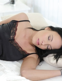 Some girls start their days with coffee, others with hot shower and this gentle but very passionate brunette prefers something spicier. Luckily, she always sleeps in silky and tiny lingerie set. So, when she feels the urge to play with her pussy, she needs just to open her eyes and to move fingers down her belly until they reach pulsating hole. Sure, she cannot be satisfied with a fingering scene and fills pussy with her favorite red sex toy.