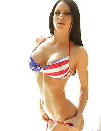 Busty fit Alluring Vixen babe Jennifer shows off her patriotic love in a sexy skimpy USA bikini