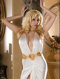 Blond Bombshell alert! Take cover and get ready for a sexy explosion! Super hot Ami shows her super big cream-colored boobies while taking off her long white and gold dress. We love how her strip of hair pokes out of her tiny white thong panties, but love it even more when she takes the panties off and struts around in her gold heels and nothing else. Take a look at one of the hottest bodies out there!