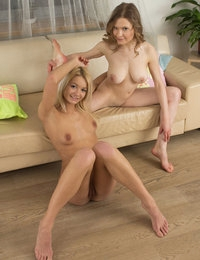 These lesbian girls enjoy getting wrapped up in each other while they lay comfortably with their legs spread.