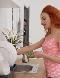 Red-haired cutie is about to cook her morning coffee, she loves starting her days with a cup of a hot drink when an older man enters the kitchen and caresses her butt. He worships her beautiful ass, as well as her flat tummy and natural tits. She in return reveals all her love for a cock that he hides inside his tight jeans. Soon, they both are totally naked and make hot sex that satisfies them both and gives them much more energy than all coffee in the whole world can.