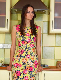 Skinny brunette gets to some serious work in the kitchen that makes her end up all naked with her legs wide open.