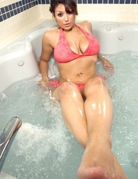 Mia plays in the hot tub