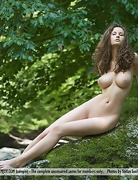 """This week's Best of Femjoy features the sensual, sexy, seductive Susann in """"Let It Shine"""". And she certainly does that. The truth is, she is always shining which is why felt it appropriate to give her the title of Best of Femjoy this week. In this photo set, photographer Stefan Soell takes her into the woods and let's her shine in nature. Simple, focused, beautiful - just like Susann herself.Here's what many of her adoring fans had to say about this latest set from one of the Best of Femjoy;""""An absolute work of art!""""""""Susann's lovely mass of wavy hair and her delightful naked bottom. I could gaze forever at the wonderful soft curving contours and smooth shape of Susann's lovely buttocks. It is such a privilege to see the stunningly beautiful bottom of such a very pretty girl. Thanks, Susann. You are gorgeous.""""""""This is a truly beautiful and elegant image. Susann is statuesque with her lovely slim figure, her beautiful long legs and her delightful shapely buttocks. Thanks, Susann, for this delightful pose. Your bottom is very pretty and so sweet.""""""""i could honestly say that even shakespeare himself would be at a loss of words to describe susann's beauty. She and bianca beauchamp are easily the two hottest women one the web. And props to stefan [you] are an awesome photographer and one lucky person to be able to work with susann.""""""""Total perfection, always!""""!"""" Many thanks, Susann and Master Soell!""""""""Wow! Always most remarkable, our dear Susann!!""""""""A marvel, indeed!!!! Hypergorgeous perfection!!""""""""Shining brightly!!! Five stars, always!!""""""""OMG, what a beautiful rear view of Susann! """"""""Susann is stunning as always.""""""""She is Still the most beautiful woman on this sight.""""Well said members. We feel the same way and we are so glad to hear that you do too. Susann is indeed a special gal and we are so glad to be able to bring that special beauty to you. If you haven't already, take the time to check out Susann's latest set - and all her other sets with Femjoy - you'll thank us later. :"""