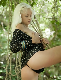 Exquisite, stunning, svelte Nika N is the Lioness of the jungle. Hunting her prey, she is  wearing a  black printed top with nothing but sheer black panties underneath.
