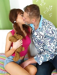 Nasty young cutie Adrianne is playing with her teddy bear when brawny hunk suddenly enters and starts alluring her. This babe is too slutty to refuse his offer. Guy starts sucking her perfect nipples and slowly goes down to her pussy. After a cunnilingus girl is completely aroused so she is ready to do all he asks. Deep blowjob continues doggy style position nailing and finally he cums in her gorgeous vagina.