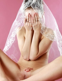 Lustful and alluring babe Brigitte caresses nipples and wears a veil
