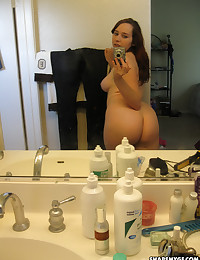 Busty girlfriend takes naked pictures of her big perky tits in the bathroom