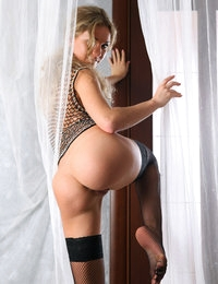 With shaved pussy exposed, this blonde amazes in raw solo posing session