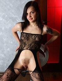 In black lingerie and with her hairy pussy exposed, Vikki is a real treat