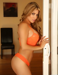Busty Alluring Vixen babe Erika teases with her perfect curves in her sexy orange lace bra top and matching thong