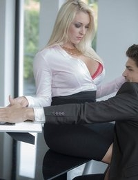 Of all the times Victoria Summers could have chosen to seduce her boss, it was during his long distance call with his wife that she finally made her move. Screw subtlety, she thought, better to show Bruce all the naughty fun he was missing out on as a married man. Victoria came right around his desk and put her assets front and center, pushing her busty cleavage in Bruce's face, and leaning way over so he could see her ass spilling out of her skirt. Once Bruce hung up, Victoria pounced on his erect cock, and gave him a sloppy dick worshiping blowjob until she couldn't wait another second to fuck. After returning the favor by licking at her pierced clit, Bruce pushed his fat cock deep into Victoria and started pumping away at her. Watch how Victoria rode his rod, and how Bruce hosed down Victoria's big breasts with a fat load of cum!