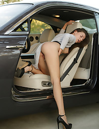 Jessica is formulating a dark erotic fantasy in the back of her mind. Seeing her seated a sleek silver luxury coupe exudes 'sex with class'. The car's smooth lines and Jessica's slender body fit like a glove. Jessica's mind floats off to a wicked place as she opens her dress and let's her hands wander. Her hard nipples, those killer legs and her wet pussy are something to behold. Jessica begins fingering her clit and finger fucking herself in a sexual reverie all her own. She imagines the warm blood pumping through her lovers' veins - and his raging hard cock. She's a Black Widow, waiting for the right moment ...