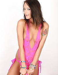 Spunky Alluring Vixen babe Sierra teases in her skimpy pink lace tank top that barely covers her perky boobs