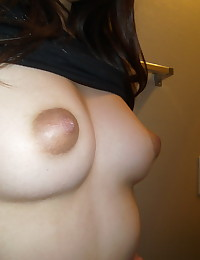 Slutty girlfriend shows off her delicious body as she takes selfshot pictures of her round ass and perky tits