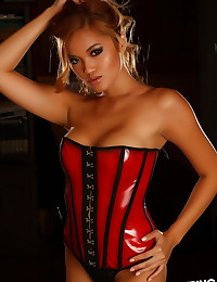 Sexy Alluring Vixen babe Jannie shows off her perfect body in a tight red and black corset