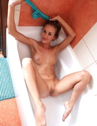 Yummy angel Larisa takes off her sexy blue lingerie in a bathroom