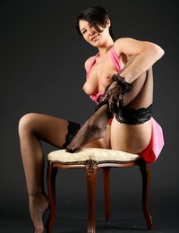 Amazing Cecelie looks magnificent in her sexy pink dress and stockings