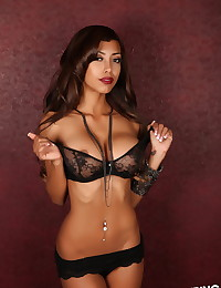 Stunning Alluring Vixen babe Jenna C teases with her big tits in a skimpy black lace almost sheer bra