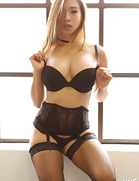 Busty Asian Alluring Vixen babe Annie teases in her sexy black lingerie with fishnet stockings