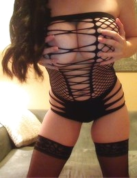 Sweet Krissy shows off her fishnet outfit on webcam